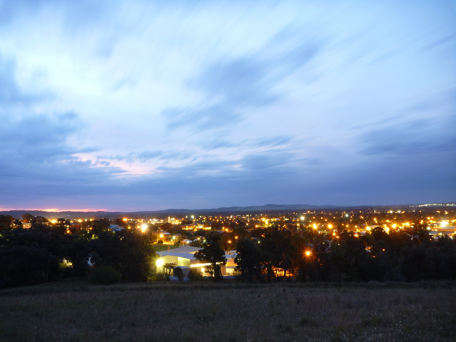 Wagga Wagga at night; lovely lighting and blurred clouds.