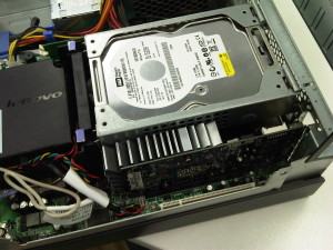 Looking inside a cramped desktop machine. This is horrible.