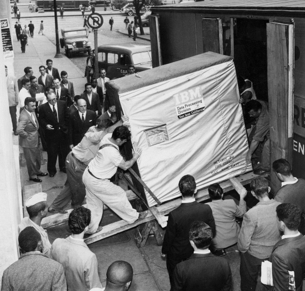 50,000 dollar hard disk drive being loaded onto a truck.
